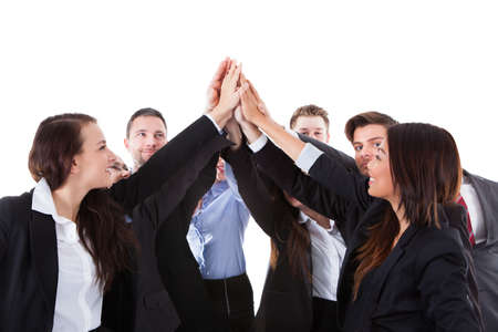 Businesspeople making high five gesture over white background photo