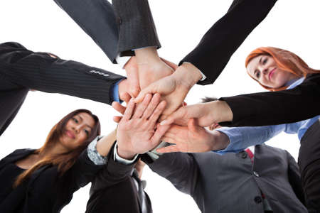 Business people stacking hands. Shot from below photo