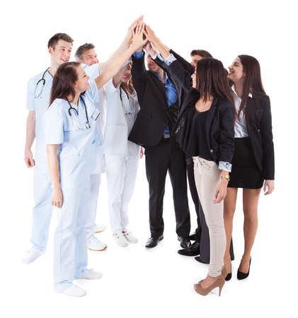 Doctors and managers making high five gesture. Isolated on white photo