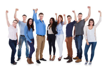 Group of diverse people raising arms. Isolated on white photo
