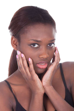 Portrait of sensuous African American woman against white background photo