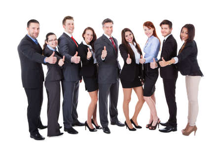 Large group of successful business people showing thumbs up sign. Isolated on white photo