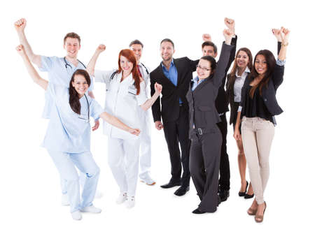 healthcare worker: Excited doctors and managers raising arms  Isolated on white Stock Photo