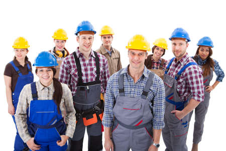 artisan: Confident diverse team of workmen and women standing grouped in their dungarees and hardhats smiling at the camera  high angle view isolated on white Stock Photo