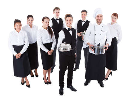 Large group of waiters and waitresses. Isolated on white photo