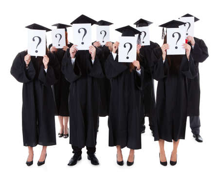 Graduate students covering face with question signs. Isolated on white photo