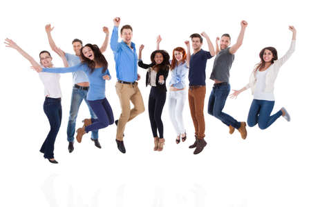 cheer: Group of diverse people raising arms and jumping. Isolated on white