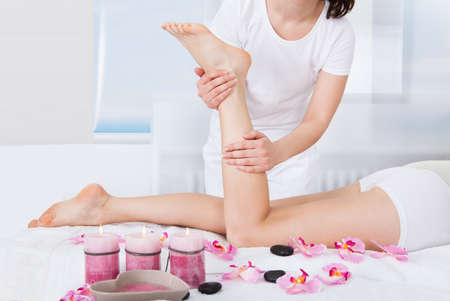 Young Woman Getting Feet Massage Treatment At Spa Stock Photo