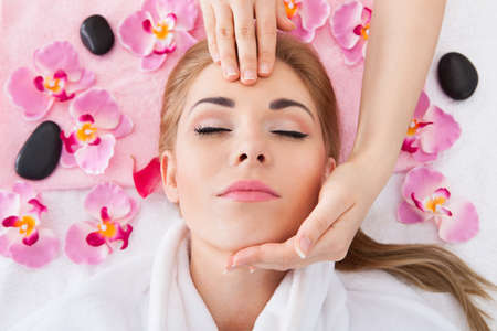 High Angle View Of Young Woman With Eyes Closed Getting Massage Stock Photo - 27021801