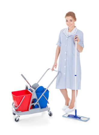 Portrait Of Young Female Maid Cleaning Floor With Mop photo