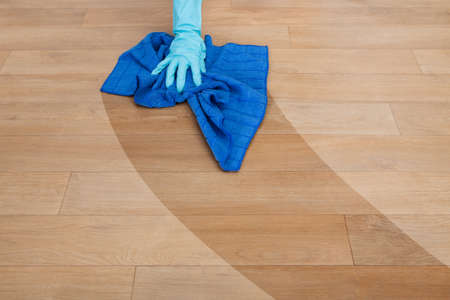 handglove: Close-up Of Maid Wearing Gloves Cleaning Floor Stock Photo
