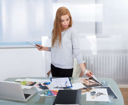 Young Woman Working With Color Samples For Selection photo