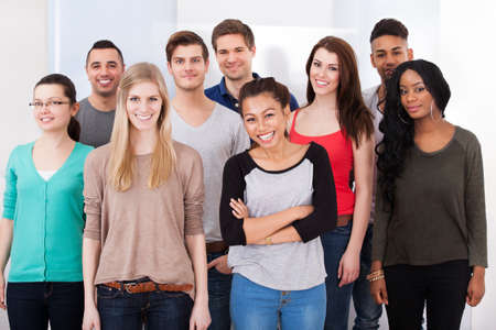 Group portrait of confident multiethnic college students standing together photo