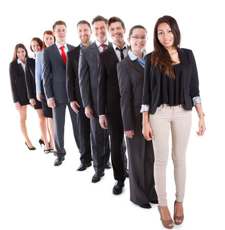 Business people standing in row over white background photo