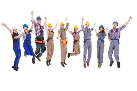 construction hat: Large diverse group of workmen and women leaping in the air and cheering at the successful completion of a team project isolated on white