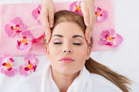 High Angle View Of Young Woman With Eyes Closed Getting Massage photo