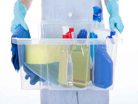 janitor: Maid Holding Bucket With Cleaning Supplies Over White Background Stock Photo