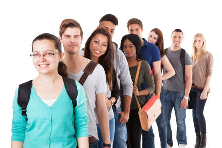 mixed races: Portrait of multiethnic university students standing in a row isolated over white background Stock Photo