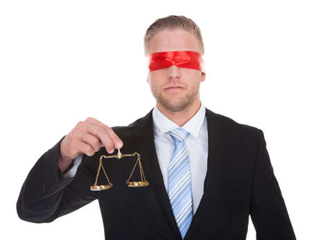 honest: Lawyer or judge with the scales of justice in his hand wearing a blindfold  conceptual of impartiality and fairness