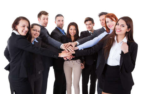 join the team: Business people stacking hands over white background Stock Photo