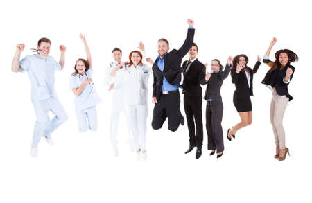 Group of doctors and managers jumping. Isolated on white photo