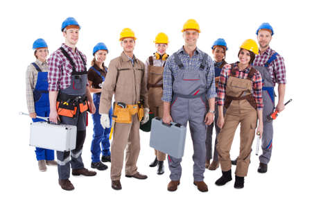 Large group of diverse workmen and women standing isolated on white photo