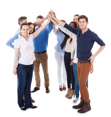 Diverse group of people making high five gesture. Isolated on white photo
