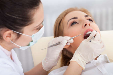 cavity braces: High Angle View Of A Woman Having Her Dental Checkup Stock Photo
