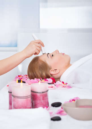 High Angle View Of Woman Getting Microdermabrasion Therapy In Spa Stock Photo - 27242166