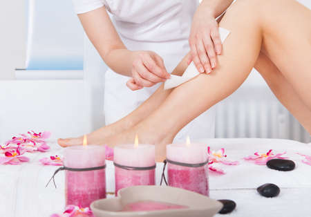 epilation: Close-up Of A Woman Getting Thigh Massage Treatment At Spa Stock Photo