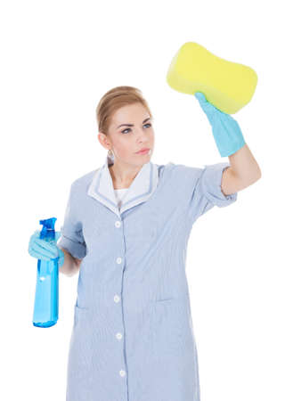 Young Happy Maid Cleaning Glass With Liquid And Sponge photo