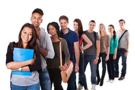 Portrait of multiethnic college students standing in a line over white background Stock Photo