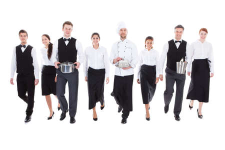 Large group of waiters and waitresses. Isolated on white Stock Photo