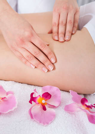 Close-up Of A Woman Getting Thigh Massage Treatment At Spa photo