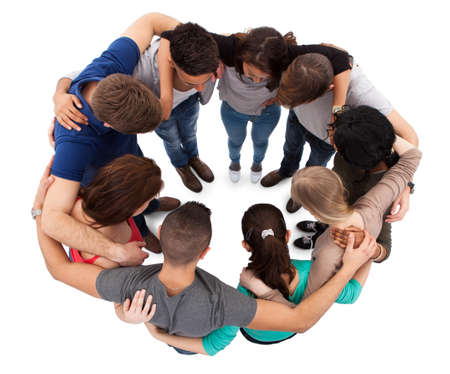 arms around: High angle view of young university students forming huddle against white background