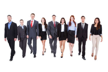 Large group of business people walking towards camera. Isolated on white photo