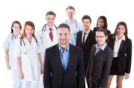 Boss standing on front of his team of doctors and managers photo