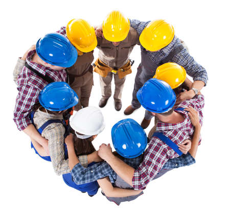construction man: Large group standing in circle. Isolated on white