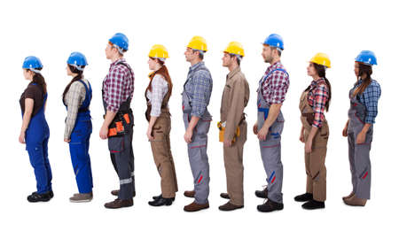Construction workers standing in queue. Isolated on white photo