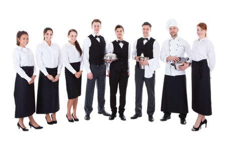 uniforme: Gran grupo de camareros y camareras. Aislados en blanco Foto de archivo