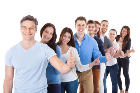 line up: Diverse group of people standing in row and showing thumbs up. Isolated on white