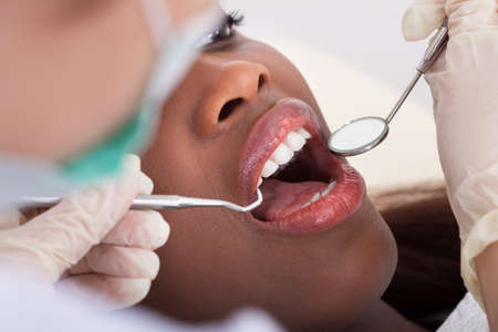 High angle view of female patient being examined by dentist in clinic photo