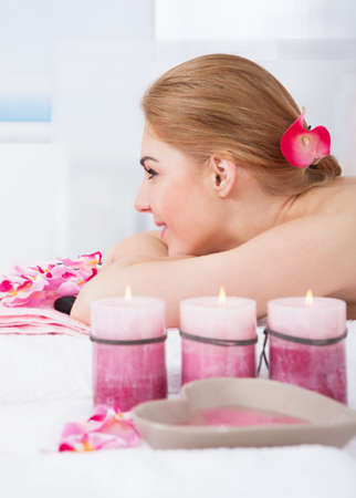 Portrait Of Smiling Young Woman Relaxing In Spa photo