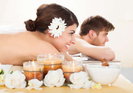 body massage: Side view of young couple relaxing in spa Stock Photo