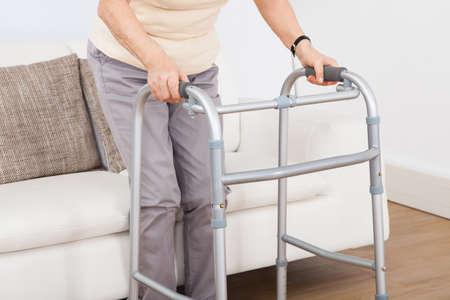Closeup of senior woman using walking frame at nursing home Stock Photo