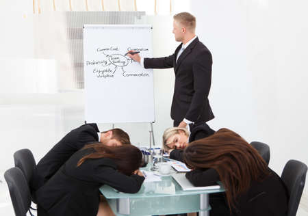 bored man: Businessman And His Colleagues Sleeping During Presentation