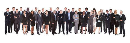 Confident business people standing against white background photo