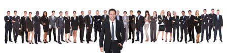 panoramic business: Portrait of confident businessman with team standing against white background