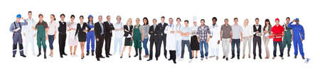 Full length of people with different occupations standing against white background photo