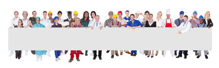 various occupations: People with various occupations holding blank billboard against white background